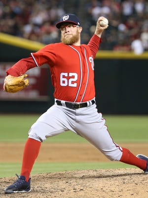 Nationals Sean Doolittle (62) pitches against the Diamondbacks in the ninth inning at Chase Field in Phoenix, Ariz. on July 22, 2017.