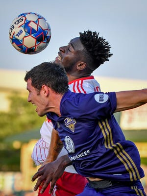 Louisville City fans enter the stadium, singing fight songs, before against New York Red Bulls II soccer match at Slugger Field in Louisville, Ky, June 30, 2018.