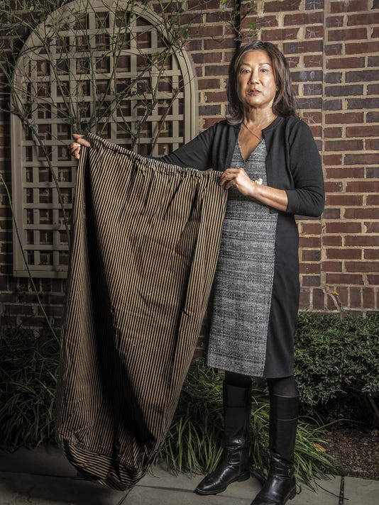 Shirley Higuchi with artifacts from her family's time in WWII internment camps at her home in Washington, DC.