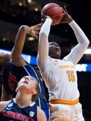 Tennessee's Cheridene Green (15) takes a shot while