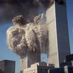 Smoke and debris erupt from the south tower of the World Trade Center as it implodes after two jets crashed into the buildings Tuesday, Sept. 21, 2001, in New York City.  Now a businessman wants to recreate the attack to settle conspiracy theories.