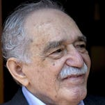 Colombian Nobel Literature laureate Gabriel Garcia Marquez greets fans and reporters outside his home on March 6, his 87th birthday. Garcia Marquez died Thursday at his home in Mexico City.