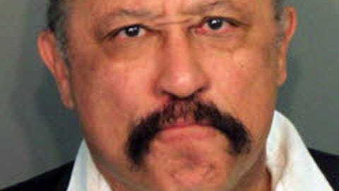 Judge Joe Brown's arrest photo in March 2014, when he was charged with five counts of contempt of court..