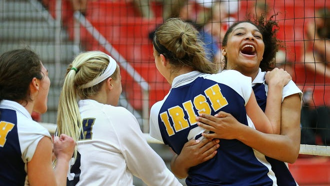 FILE – Cathedral's Nia Robinson, right, celebrates their win with teammate Audrey Adams after beating Center Grove in 2015.