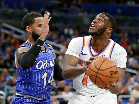 New York Knicks' Emmanuel Mudiay, right, looks for a shot against Orlando Magic's D.J. Augustin (14) during the first half of an NBA basketball game Wednesday, April 3, 2019, in Orlando, Fla. (AP Photo/John Raoux)