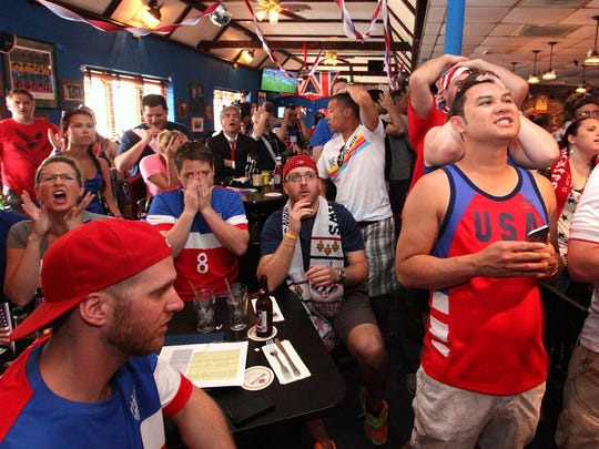 USA fans at Stoney's on Concord Pike react as Germany scores on the U.S. team in the World Cup Thursday, June 26, 2014.