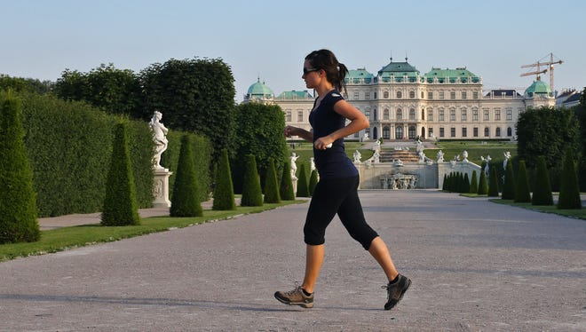 A woman jogs in the gardens of Belvedere Palace in Vienna.