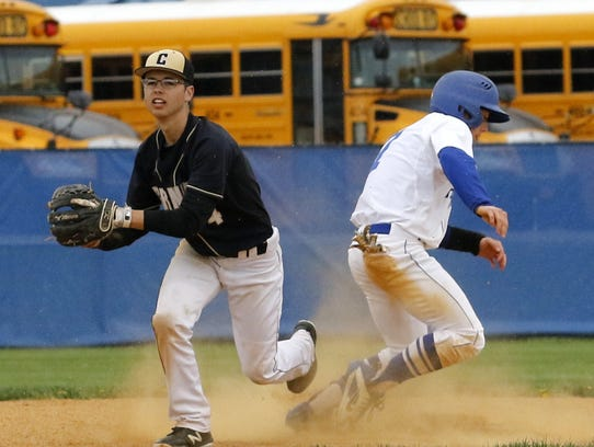 Corning second baseman Christopher Durkin forces out