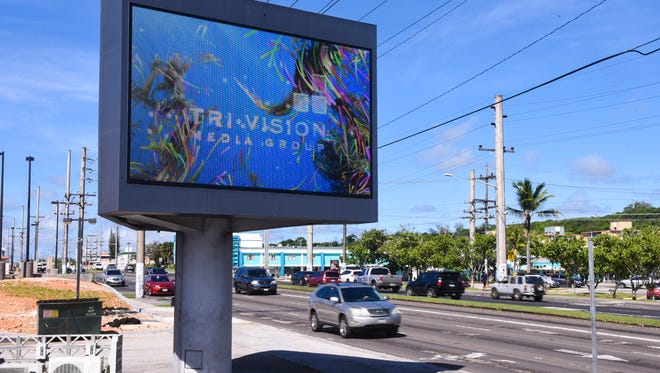 Motorists drive pass an electronic LED billboard posted near the ITC intersection in Tamuning on Tuesday, July 25, 2017. Senators on Nov. 18, 2019 passed a bill that would allow large digital signs to be placed on most buildings in Tumon Bay.
