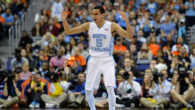 North Carolina Tar Heels guard Marcus Paige (5) celebrates after scoring in the second half  against the Virginia Cavaliers during the championship game of the ACC conference tournament.
