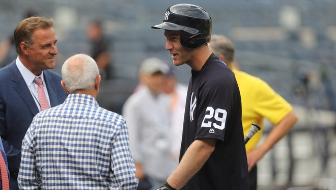 Todd Frazier, right, speaks to Al Lieter, left, who also grew up in Ocean County, N.J., before Frazier gets ready to play his first game at a Yankee at Yankee Stadium, Tuesday, July 25, 2017.
