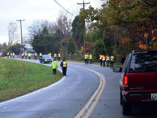Search crews return to command post after a six-year-old
