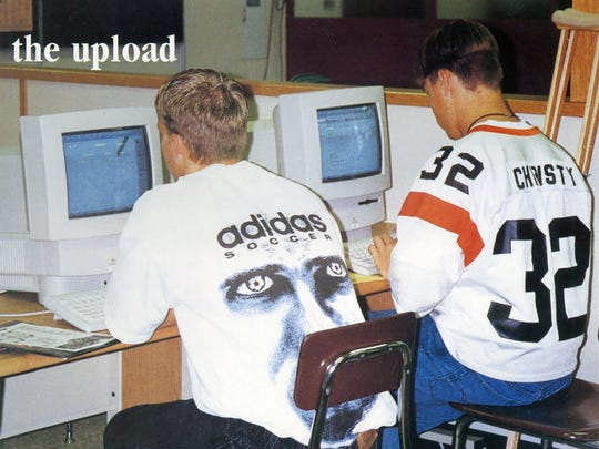 Grant Christy and a friend use some of the new Macintosh