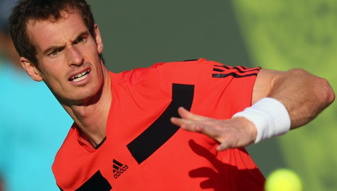 Britian's Andy Murray returns the ball to Qatar's Mousa Shanan Zayed during their match in Qatar's ExxonMobil Open in Doha on Dec. 31, 2013. Murray won the match 6-0, 6-0.