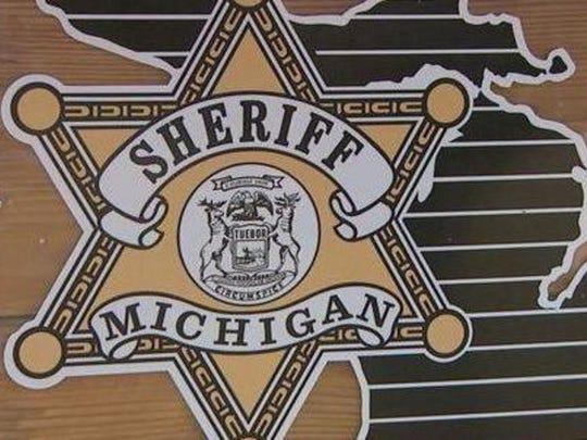 Sheriff's badge.