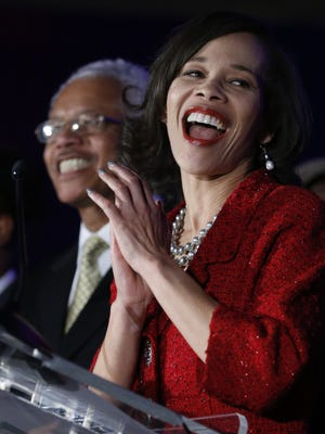 U.S. Rep.-elect Lisa Blunt-Rochester celebrates her victory surrounded by supporters, including her father, Ted Blunt, at the Democratic gathering at the DoubleTree Hotel in Wilmington on Nov. 8.