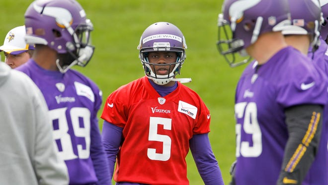 Teddy Bridgewater (5) is among three players vying to be the Vikings' starting quarterback.