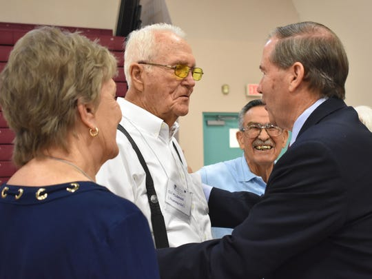 Alamogordo resident Clif Mcdonald is embraced by Udall.