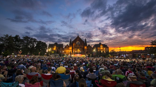 The sun sets over Music Hall during the 2015 Lumenocity concert at Washington Park in the Over-the-Rhine neighborhood of Cincinnati.