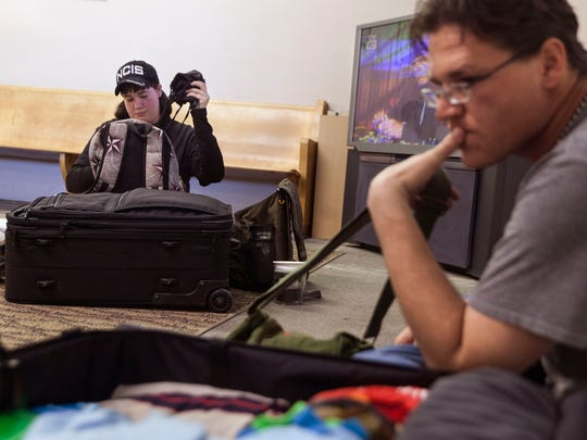 Holly Cline, left, and Matthew Smithson pack their bags preparing to leave the Valley Mission for South Dakota on March 31, 2015. The couple struggled to find affordable housing in the area, prompting the move.