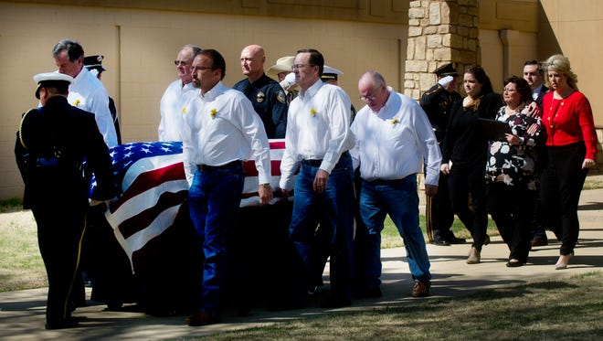 Pallbearers are followed by the wife and daughters of Abilene police officer David Varner after the conclusion of Varner's service at Southern Hills Church of Christ on Tuesday, March 7, 2017.
