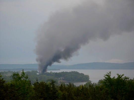 Smoke billows from a house fire Tuesday evening along