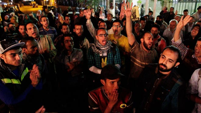 Supporters of Egypt's ousted President Mohammed Morsi raise their hands with four raised fingers that became a symbol for the supporters during a rally in Cairo's Nasr City district on Sunday.