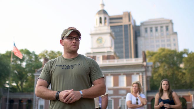 USMC Sergeant Andrew Einstein of Riverton, a Westampton Township Police Officer and volunteer firefighter in Mount Laurel and Riverton stands outside Independence Hall Tuesday morning before the trip.