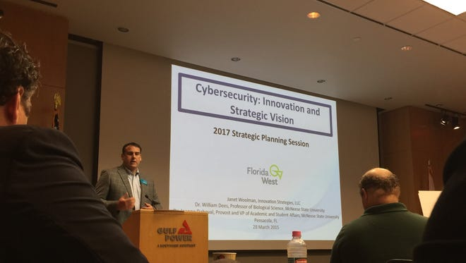 Scott Luth, CEO of FloridaWest Economic Development Alliance, speaks on Tuesday, March 28, 2017, at Gulf Power Company's downtown office in Pensacola. The organization organized a meeting to gather input on the cybersecurity industry.