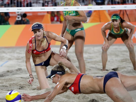 United States' Kerri Walsh Jennings, left, watches her teammate April Ross, right, trying to reach a ball during a women's beach volleyball semifinal match against Brazil at the 2016 Summer Olympics in Rio de Janeiro, Brazil.