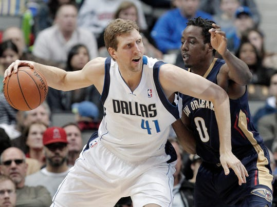 FILE - In this Feb. 26, 2014, file photo, Dallas Mavericks' forward Dirk Nowitzki (41) battles New Orleans Pelicans' Al-Farouq Aminu (0) during the second half of an NBA basketball game in Dallas. Nowitzki and the Mavericks have agreed on what could be the final contract for him. A person with knowledge of the deal told The Associated Press on Thursday, July, 2014, that Nowitzki would get a three-year contract worth roughly $30 million. (AP Photo/Brandon Wade, File)