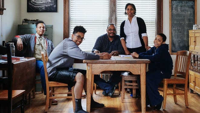 Kevin Waterman 53, center, of Detroit and his wife, Abbey Waterman, 51, pose with their children, three of eight who have been homeschooled, Kaleb Waterman, 18; Klark Waterman, 15; and Kole Waterman, 9.