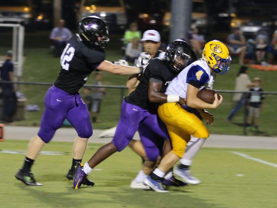 Riverside's Stone Frost is tackled by a TCA defender.