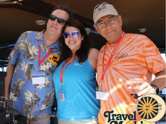 Kermit Duhon, right, stands with Maegan Sonnier of Travel Machine and DJ Todd Ortego on the KBON Cruise