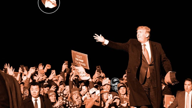 President Donald Trump tosses a hat to supporters as he arrives to speak at a campaign rally at Duluth International Airport, Wednesday, Sept. 30, 2020, in Duluth, Minn.