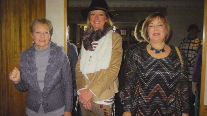 Mary Allen (left), Rhonda Ryan and Marie Garrettson modeled fashions at the American Association of University Women annual fashion show Nov. 15 at Port Huron Golf Club. The event raised money for the educational foundation that provides funds to advance education, research and self-development for women.
