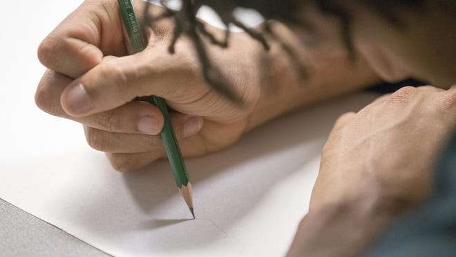 A juvenile detainee works on a piece during an art class at the Marion County Jail, Indianapolis, Monday, Oct. 10, 2015. The program gives inmates a chance to learn drawing and history about artists of note.