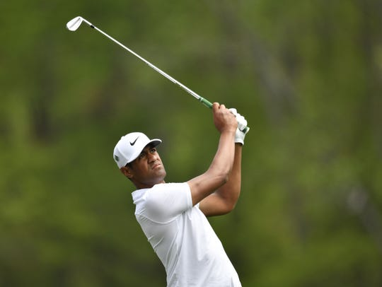 Tony Finau hits his tee shot on the 12th hole during