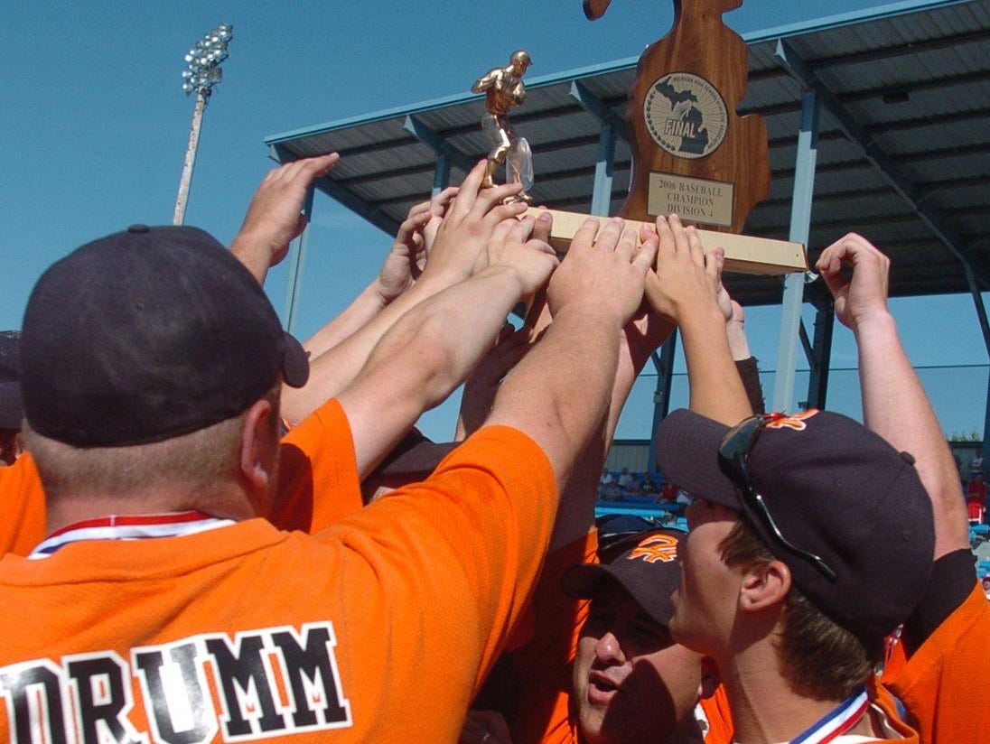 Homer baseball coach Scott Salow (center) and the Trojans celebrate their 2006 Division 4 State Championship.
