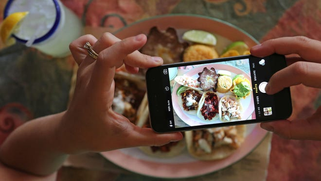 Food writer Megan McCaffrey snaps a photo of her taco lunch at Coyote Flaco in Port Chester as part of her taco tour.