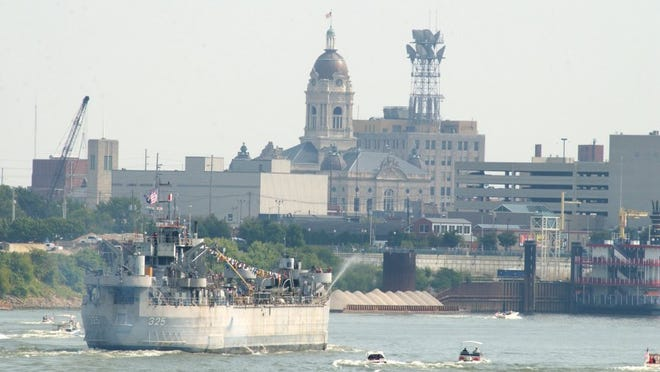 LST 325 passes the old courthouse on its way to the Evansville Riverfront.