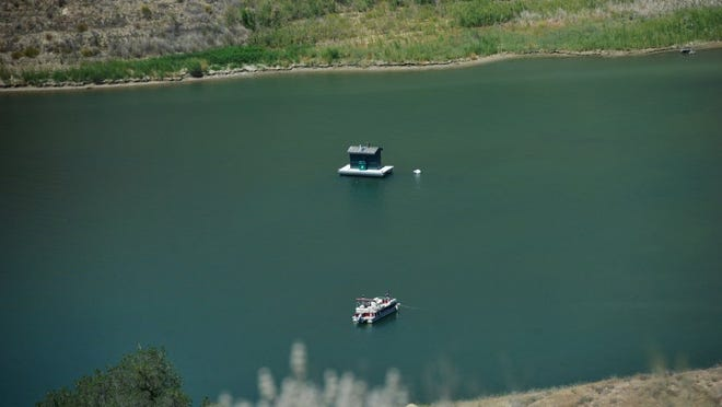 A boat glides through Lake Piru.