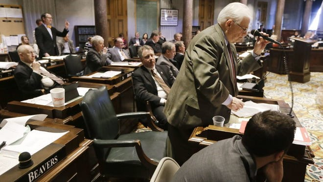 Sen. Ken Yager, R-Kingston, standing right, sits down as Sen. Bo Watson, R-Hixson, standing left, seeks recognition to speak during debate on Watson's deannexation bill Monday, March 21, 2016, in Nashville, Tenn. Yager successfully argued that the bill approved by the House last Monday is substantially different from the bill recommended by his committee last year. The Senate voted to send the bill back to committee for review, delaying a Senate floor vote at least until Thursday. (AP Photo/Mark Humphrey)