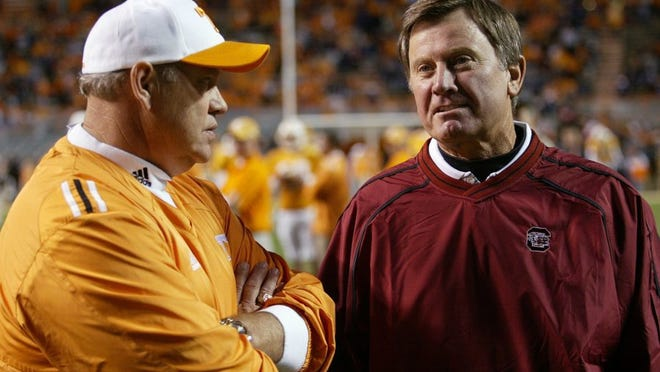 ** FILE ** In this Oct. 29, 2005 file photo, South Carolina coach Steve Spurrier, right, talks with Tennessee coach before an NCAA college football game in Knoxville, Tenn. Through most of the 1990s, games between Phillip Fulmer's Tennessee Volunteers and Steve Spurrier's Florida Gators helped decide Southeastern Conference championship and national titles. On Saturday, the two winningest active coaches in the SEC will be playing for the inside track to fourth place in their division. (AP Photo/Wade Payne, File)