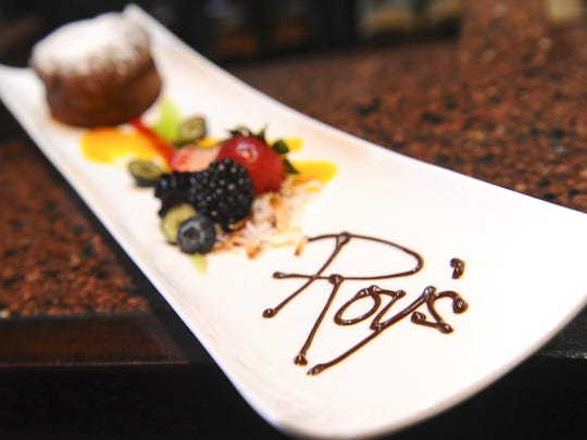 The flourless chocolate souffle with a berry medley served with mango, kiwi and raspberry sauces prepared at Roy's restaurant inside the Hilton Guam Resort & Spa in Tumon, June 2014.