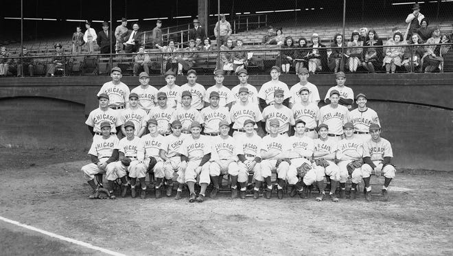 The Chicago Cubs, winners of the National League pennant for 1945, are shown in this Sept. 28, 1945, photo, taken the day before the team won the National League pennant. From left to right, front row are: Stan Hack, Reggie Otero, Hank Borowy, Peanuts Lowrey, Roy Johnson, Charlie Grimm, Milt Stock, Hy Vandenberg, Claude Passeau, Roy Hughes, Johnny Ostrowski, Bill Schuster. Second row: Johnny Moore, Lennie Merullo, Phil Cavarretta, Andy Pafko, Bill Nicholson, Heinz Becker, Mickey Livingston, Bob Chipman, Lon Warneke, Cy Block. Third row: Paul Gillespie, Clyde McCullough, Ed Sauer, Len Rice, Dewey Williams, Bobby  Sturgeon, Paul Erickson, Frank Secory, and Hank Wyse.