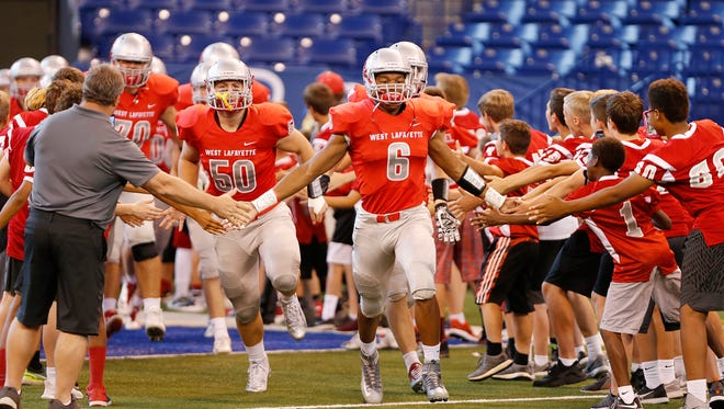 The West Lafayette Red Devils take the field to face the Rensselaer Bombers Saturday, September 16, 2017, at Lucas Oil Stadium in Indianapolis. West Lafayette thumped Rensselaer 55-6.