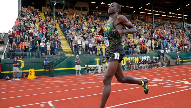 Oregon's Edward Cheserek crosses the finish line to win the men's 10,000 meters at the NCAA outdoor track and field championships in Eugene, Ore., Wednesday, June 8, 2016. (AP Photo/Ryan Kang)