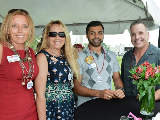 Veronica Kolibab, left, Margaret Tanner, Dr. Ravi Jitta and Mark Trembley celebrate the opening of a new St. Lucie Battery & Tire store in Port St. Lucie on June 22.