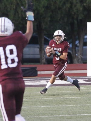 Lions quarterback Chance Jones prepares to pass in the game with China Spring.
